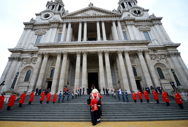 Members of the armed services carry the coffin away from St Paul's Cathedral.