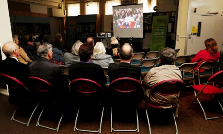 People watch a live broadcast of Baroness Thatcher's funeral at the Grantham Museum in Grantham, Lincolnshire.
