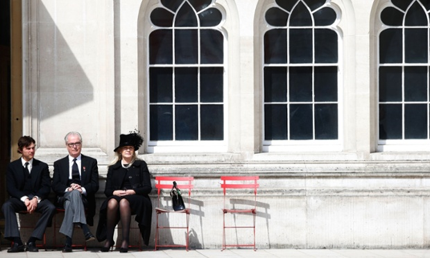 Guests relax outside the Guildhall in the City of London at a reception following the funeral.