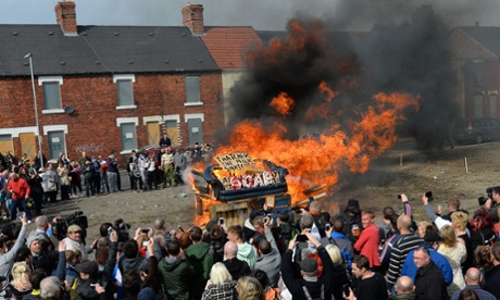 An effigy of Margaret Thatcher in a 'coffin' is burnt together with a sofa and wood as people gather to celebrate the death of Margaret Thatcher in Goldthorpe, northen England.