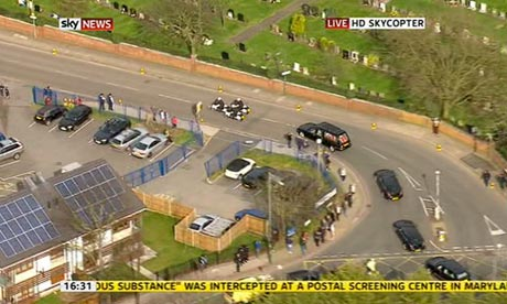 Lady Thatcher's hearse arrives at Mortlake crematorium.