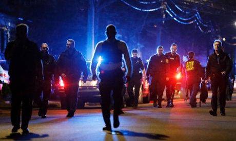 Police officers walk near a crime scene in Watertown after a tense night of police activity that left a university officer dead on campus just days after the Boston Marathon bombings.