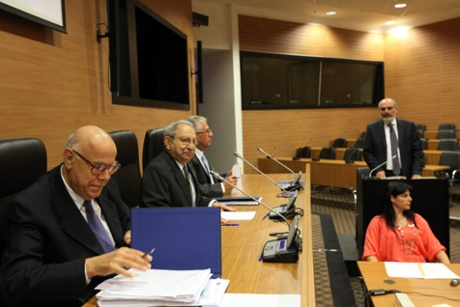 Cyprus's finance ministry permanent secretary Christos Patsalides (background right) starts testifying, Nicosia Friday 19 April 2013, into the economic circumstances leading to the turmoil of an EU sanctioned bailout for the troubled Mediterranean island.