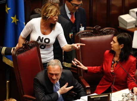 PDL (People of Freedom party) member Alessandra Mussolini (L) gestures with Lower house president Laura Boldrini during the second day of the presidential election in the lower house of the parliament in Rome April 19, 2013. I
