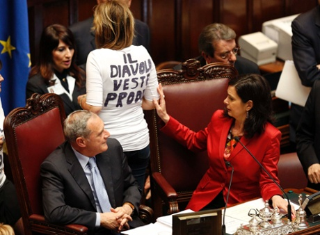 Lower house president Laura Boldrini (R) checks the t-shirt of  PDL (People of Freedom party) member Alessandra Mussolini (C) during the second day of the presidential election in the lower house of the parliament in Rome April 19, 2013.