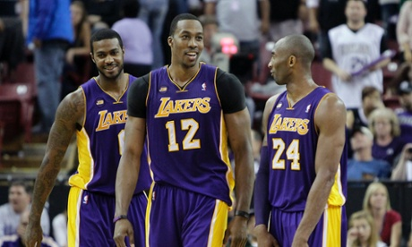 Los Angeles Lakers' Earl Clark, left, Dwight Howard, center, and Kobe Bryant smile during the closing moments of the Lakers 103-98 win over the Sacramento Kings in an NBA basketball game in Sacramento, Calif., Saturday, March 30, 2013. (AP Photo/Rich Pedroncelli)
