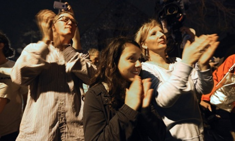 Onlookers applaud first responders departing after their successful operation to capture 19-year-old Boston bombing suspect Dzhokhar Tsarnaev on in Watertown, Massachusetts.