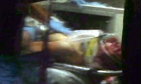 This still frame from video shows Boston marathon bombing suspect Dzhokhar Tsarnaev visible through an ambulance after he was captured in Watertown, Massachusetts.