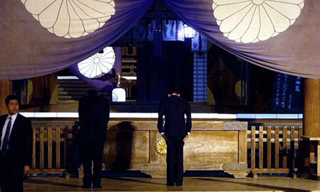 Taro Aso, Japan's deputy prime minister and finance minister, bows at the Yasukuni shrine in Tokyo