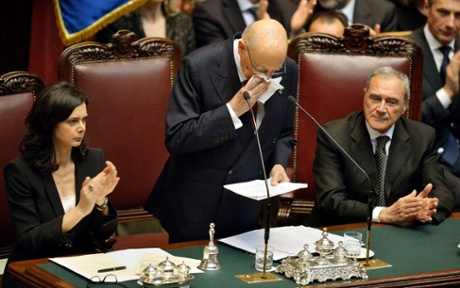 Re-elected Italian President Giorgio Napolitano (C) addresses deputies and senators next to Laura Boldrini (L), president of the Italian Parliament and Pietro Grasso, president of the Italian senate, at the Italian Parliament in Rome on April 22, 2013.