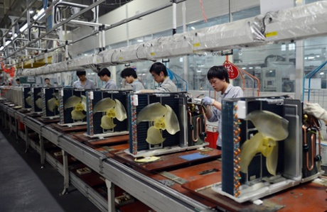 Workers assembling air conditioners at a factory of Gree Electric Appliances in Wuhan in central China's Hubei province 18 April 2013.