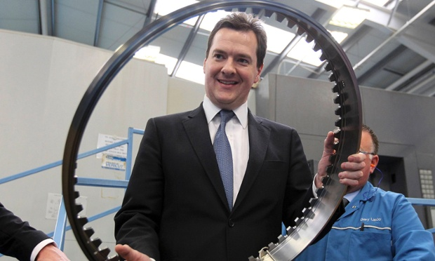 George Osborne holds a machined part during a visit to the CNC milling section at Castle Precision Engineering in Glasgow April 23, 2013.