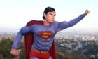 Christopher Dennis poses for a picture dressed as Superman overlooking Downtown Los Angeles, California