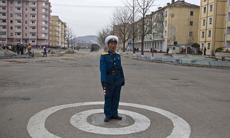 A North Korean traffic policeman stands at an intersection in Kaesong