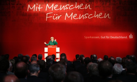 Chancellor Angela Merkel at a savings bank conference. Photograph: Reuters/Fabrizio Bensch