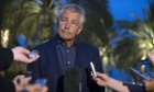 US secretary of defense Chuck Hagel speaks with reporters after reading a statement on chemical weapon use in Syria during a press conference in Abu Dhabi