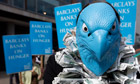 A Barclays protester, dressed to look like the bank's logo, demonstrates outside the AGM in London