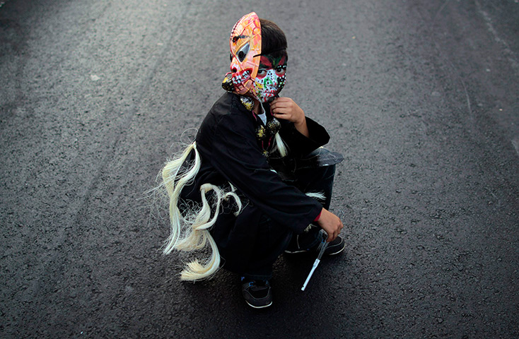 24 hours: Managua, Nicaragua: A boy with a mask and a painted face