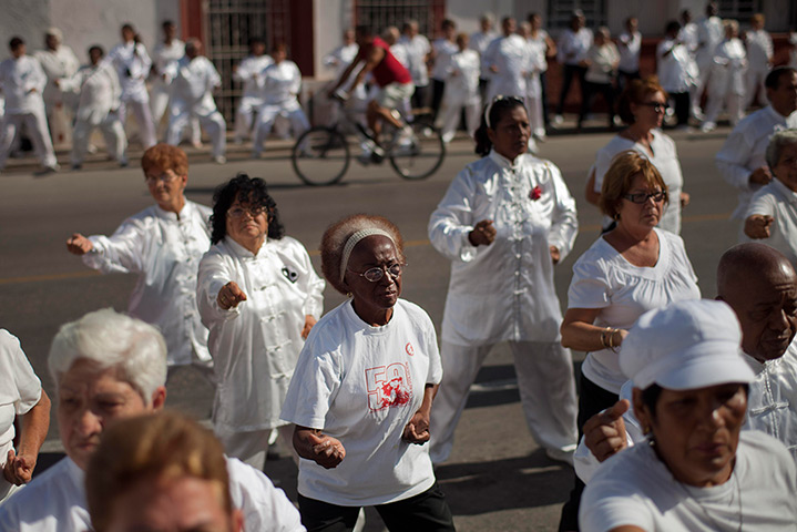 24 hours: Old Havana, Cuba: People attend an outdoor mass Tai Chi session