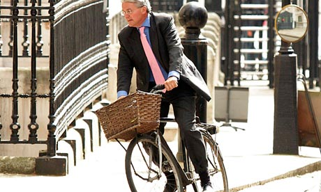 Andrew Mitchell on the bike he is selling to raise money for charity