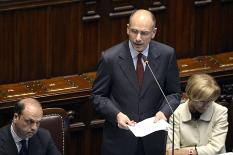 Italy's new Prime Minister Enrico Letta delivers his speech at the Parliament in Rome on April 29, 2013, next to his vice Premier and Interior Minister Angelino Alfano (L) and Foreign Minister, Emma Bonino (R).