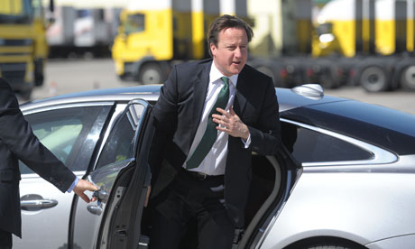 David Cameron emerges from car