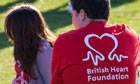 London Marathon spectators wearing British Heart Foundation T-shirts