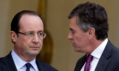 French president Francois Hollande (l) in discussion with budget minister Jerome Cahuzac