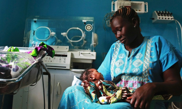 A woman holds her newborn baby in a nursery at the Juba Teaching Hospital. Very few births in South Sudan, which has the highest maternal mortality rate in the world at 2,054 per 100,000 live births, are assisted by trained midwives.