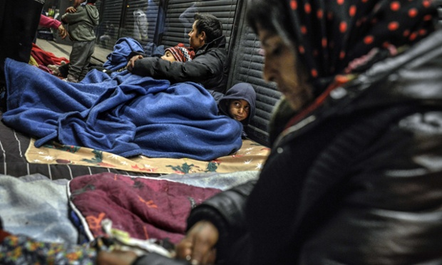 People of the Roma community in France, who were evicted from their camp a few days ago, prepare to sleep in a street in front of Lyon's administrative court, as they wait on a court decision regarding their rehousing.