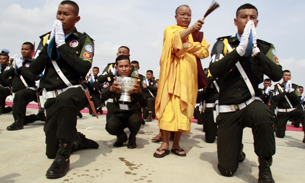 A Buddhist monk blesses Cambodian peacekeepers with holy water at the military airbase in Phnom Penh, Cambodia. Today Cambodia sent the second batch of 152 military police and medics to South Sudan in order to take part in the United Nations peacekeeping operations.