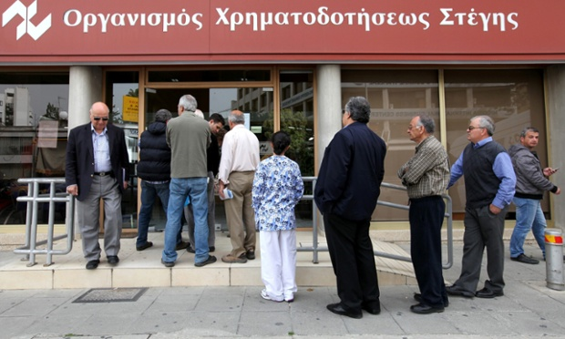 People queue outside a branch of Cyprus' Housing Finance Corporation, in Nicosia. Cyprus bank workers will hold a two-hour strike today against the cuts in pension funds as part of the international bailout.