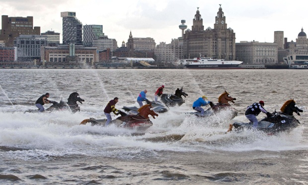 Sea horses: jetskis in the shape of horses, with the riders dressed as jockeys, take part in the Coral National, a 500m race on the river Mersey in Liverpool.