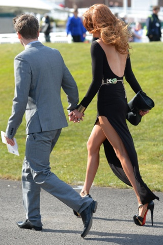 Another scene from Aintree, this time a racegoer wearing an unfeasibly skimpy dress for today's temperature in north-west England.