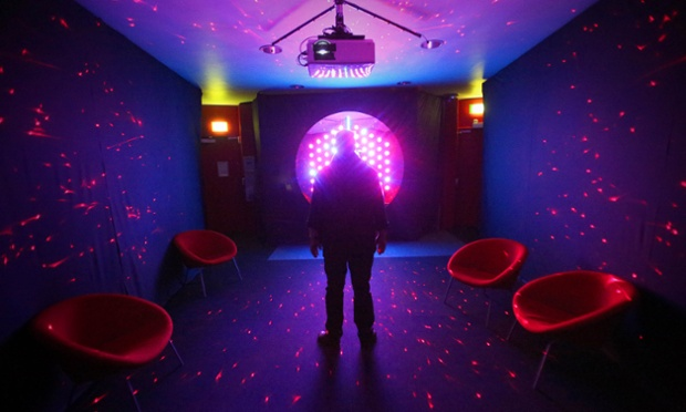 A visitor stands in the 3D sound installation which is part of the Strictly Science exhibition to celebrate 100 years of the Medical Research Council at Imperial College in London.