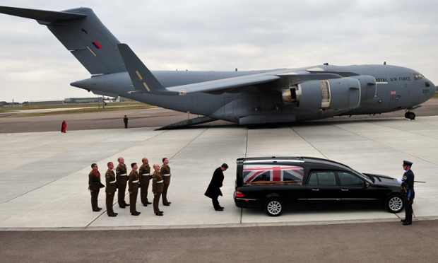 A sad scene: a photograph issued by the Ministry of Defence of the repatriation ceremony at RAF Brize Norton, Oxfordshire, of Lance Corporal Jamie Webb, of 1st Battalion The Mercian Regiment (Cheshire). Lance Corporal Webb died as a result of wounds sustained during an insurgent attack on his patrol base in the Nad-e Ali district of Helmand province, Afghanistan.