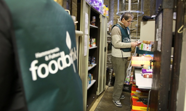 Volunteer Ken Fountayne assembles food boxes at the Hammersmith and Fulham Foodbank charity at St Simon's church in London.