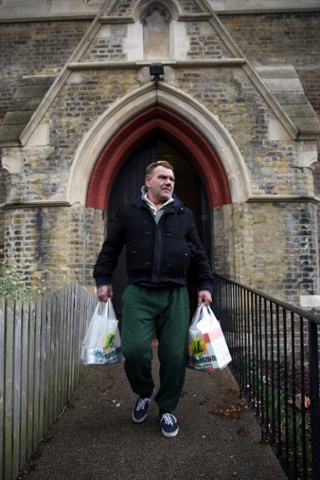 Gary leaves the Hammersmith and Fulham Foodbank charity after receiving food.