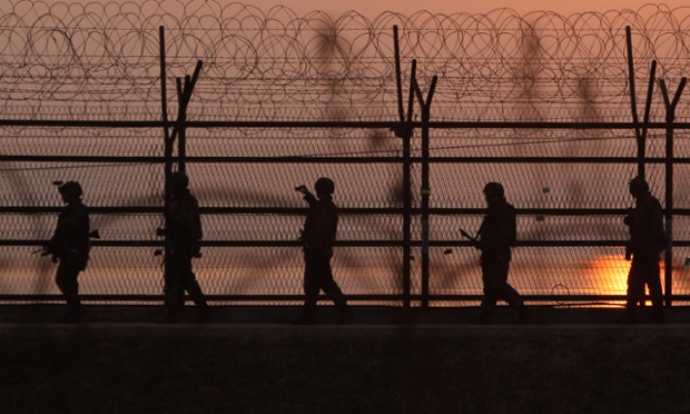 South Korean soldiers patrol inside the barbed-wire fence near the border village of Panmunjom in Paju, South Korea.