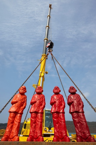 Four Karl Marx figures, each coloured a different shade of red, created by artist Ottmar Hoerl, are unveiled on the  premises of a crane company in Trier, Germany. The figures are part of an installation and will be on display in May, in the exhibition 'Icon Karl Marx' at the City Museum of the Simeonstift.