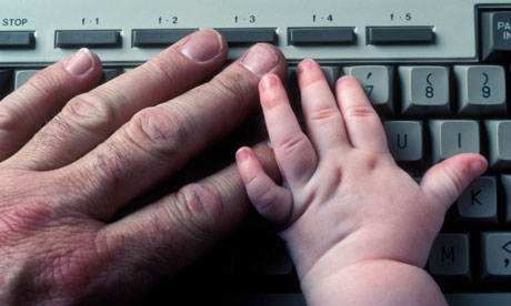 baby's and man's hand on keyboard