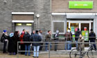 A queue of jobseekers outside a job centre in north London