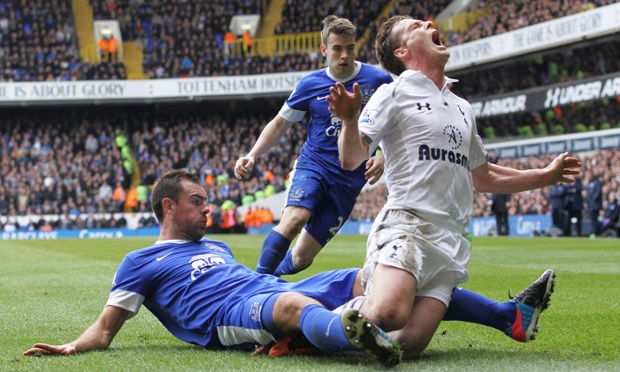 Tottenham's Scott Parker is tackled by Everton's Darron Gibson during the 2-2 Premier League draw at White Hart Lane.