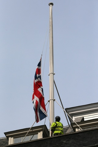 A workman lowers the flag flying above Downing Street to half-mast at the news of the death of Baroness Thatcher on April 8, 2013 in London, England. It has been confirmed that Lady Thatcher has died this morning following a stroke aged 87.