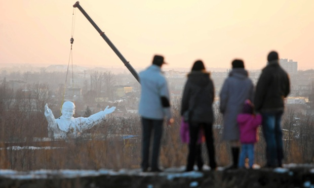 A 14-metre-high monument to the late Pope John Paul II is winched into position in Czestochowa, Poland.