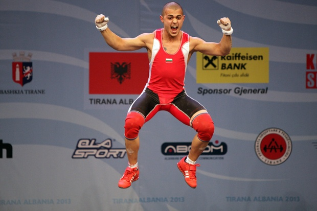 Asen Muradov of Bulgaria celebrates after lifting 118 kg during the man's + 56kg category at the Weightlifting European Championships in Tirana, Albania.