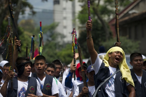 Colombian natives shout slogans during the march in Medellin, Colombia. The march is in support of the peace process between the FARC guerrillas and the Colombian government which is underway in Havana, Cuba. Photograph: Raul Arboleda/AFP/Getty Images