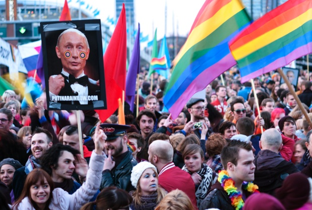 A demonstrator holds up a picture depicting Russian President Vladimir Putin with rainbow circles on his face, during a protest by the gay community in Amsterdam. Putin is on one-day visit in the Netherlands for the start of the Netherlands-Russia Year.