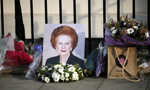 Flowers laid outside the residence of Baroness Thatcher at Chester Square after her death was announced yesterday.