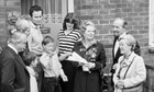 Margaret Thatcher hands over the deeds to a council house buyer